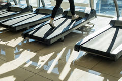 Treadmills in gym hall. Royalty Free Stock Image
