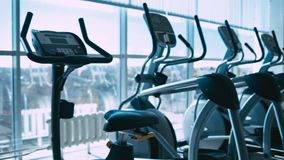 Treadmills in gym. Horizontal panning. Shallow depth of field stock video footage