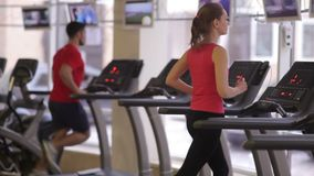 Treadmills in the modern gym. People are training on treadmills stock video