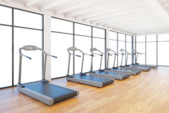 Treadmills staying in gym Stock Image