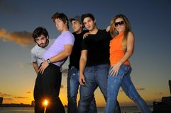Treandy team of young people posing at sunset Stock Photo