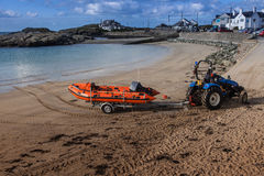 Trearddur Bay inshore Lifeboat. Trearddur Bay Lifeboat crew and inshore boat practicing off the beach Isle of Anglesey North Wales Royalty Free Stock Photos