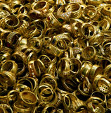 Treasure. Pile of golden rings stock photo