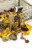 Treasure. Jewelry laying over jewelry box Stock Photography