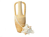 Treasure. Ancient amphora, tropical sea shell and pearls over white royalty free stock images
