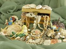 Treasure. Box full of jewelry in an underwater theme Stock Photo