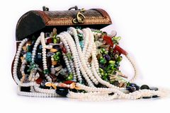 Treasure. A wooden treasure chest full of jewelery Stock Images