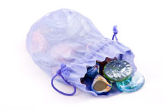 Treasure. In a violet pouch Stock Photography