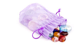 Treasure. In a violet pouch Royalty Free Stock Images