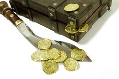 Treasure. An old case for storing items, Large hunting knife made of metal and wood, Closeup of a gold coins purchased as an investment, Pirate treasure chest Stock Image