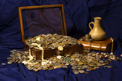 Treasure. Chest full of coins and jewelry Stock Photography