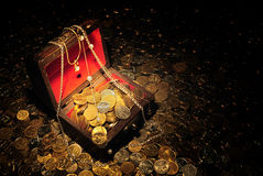 Treasure. Scattering of coins around and inside trunk with treasure royalty free stock photo