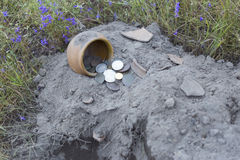 Treasure ancient coins dug out of the ground. Search for treasure using a metal detector and shovel stock images