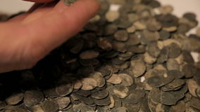 The treasure of ancient coins on the table. Hands Treasure Hunt prevent treasure of silver coins stock footage
