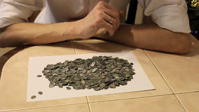 The treasure of ancient coins on the table. Hands Treasure Hunt prevent treasure of silver coins stock video