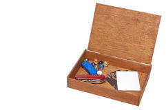 Treasure Box. An old cigar box containing boy toys and treasures Royalty Free Stock Photos