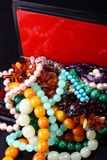 Treasure box. A jewelry box full of colorful necklaces and bracelets royalty free stock images