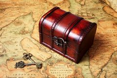 Treasure box on ancient map background Stock Photography