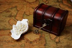 Treasure box on ancient map background Stock Photos
