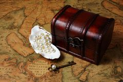 Treasure box on ancient map background Royalty Free Stock Photos