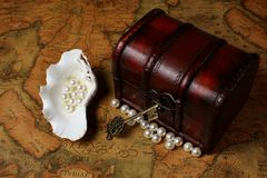 Treasure box on ancient map background Royalty Free Stock Photography