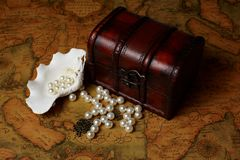 Treasure box on ancient map background Royalty Free Stock Image