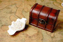 Treasure box on ancient map background Royalty Free Stock Photo