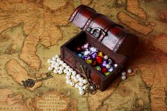 Treasure box on ancient map background Royalty Free Stock Images