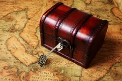 Treasure box on ancient map background Stock Photo
