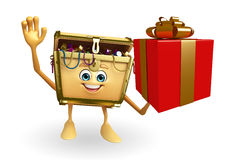 Treasure box character with gift box Stock Photo