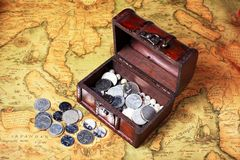 Treasure box and coins Stock Photos