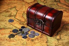 Treasure box and coins Stock Photography