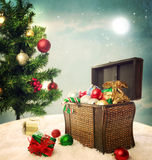 Treasure box filled with Christmas ornaments and presents Stock Images