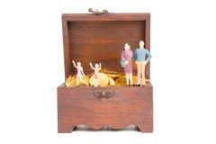 Treasure box miniature people Royalty Free Stock Photo