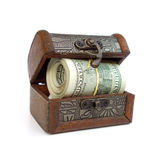 Treasure box with money roll. Isolated on white Stock Photography