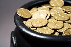 Treasure: Cauldron Full of Shamrock Coins Stock Photography