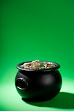 Treasure: Cauldron Full of US Coins with Copyspace Stock Image