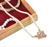 Treasure chest. Chest Opened jewelry box shows pearls chain Stock Photography