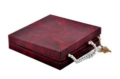 Treasure chest. Chest closed jewelry box shows pearls chain Stock Photos