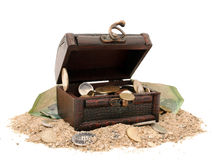Treasure Chest. Filled with different types of currencies stock photography