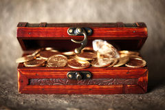 Treasure chest. Full of coins and diamonds stock photography