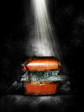Treasure chest. A brown treasure chest with money falling out under a bright light coming from above. Concept for a financial windfall or success stock illustration