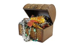 Treasure chest. A wooden treasure chest filled with loot royalty free stock photography