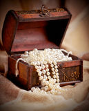 Treasure chest. Still life with wooden treasure chest with pearl necklaces royalty free stock images