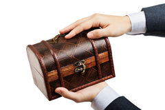 Treasure chest. Business man hand holding old antique brown wood treasure chest or box white isolated Royalty Free Stock Photos