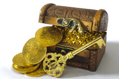 Treasure chest. With gold coins and key stock photo