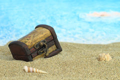 Treasure chest. Closed treasure chest on a beach royalty free stock image