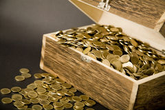 Treasure-chest. Old treasure-chest full of coins Royalty Free Stock Photography