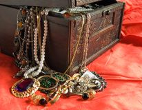 Treasure chest. Wooden treasure chest with valuables in red Royalty Free Stock Images