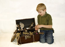 Treasure Chest. Seven year old boy with a full treasure chest Stock Image